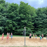 Camp kids playing Beach Volleyball