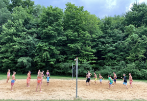 kids playing sand volleyball